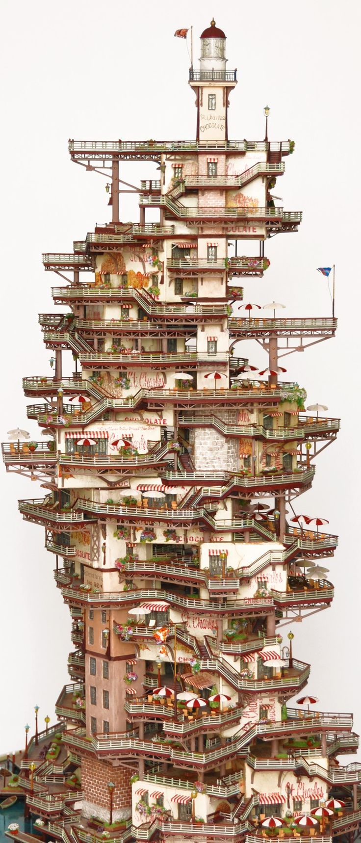 Mineatures and Bonsai Trees: the work of Takanori Aiba, a Japanese wizard of miniature artistry with a specialty in making Bonsai treehouses and tiny tourist resorts from a parallel universe.