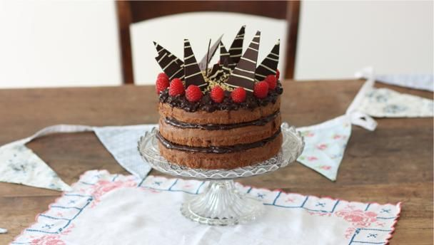 Andrew used his Gran's recipe for a classic light chocolate cake and topped it with chocolate icing, chocolate shards, hazelnuts and raspberries for a spectacular finish.  For this recipe you will need 3 x 18cm/7in sandwich tins and a large piping bag fitted with a large closed star nozzle.