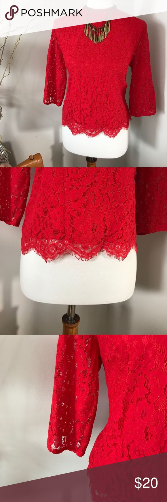 Candy apple red lace high neck top Beautiful flattering and powerful! Dress up and down. Inside the shirt has a little rip but cannot be seen on the outside :) Tops Crop Tops