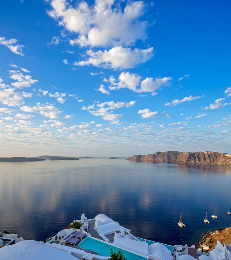 Katikies Hotel | Good morning! | puffy clouds, blue sky and the calm Aegean Sea
