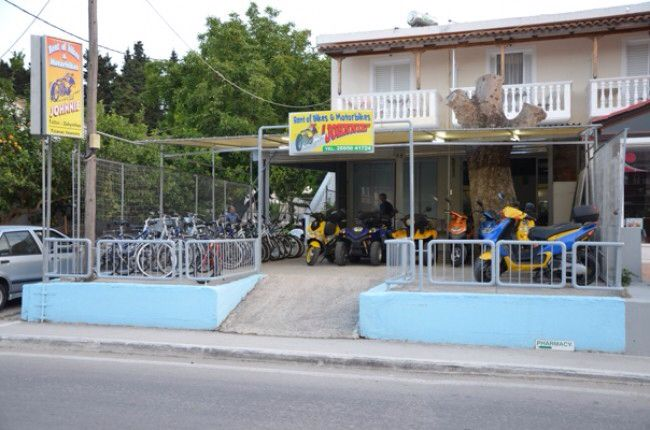 Jonnie Rents is located  at the beggining of Tsilivi resort on the main strip. Need a bike? Just visit Jonnie.   You will find many type of motorbikes and scooters but also bicycles for those that are more athletic types.   Reservations available only at the store and not by phone.   Also the store offers service in case you have damage while at the street.