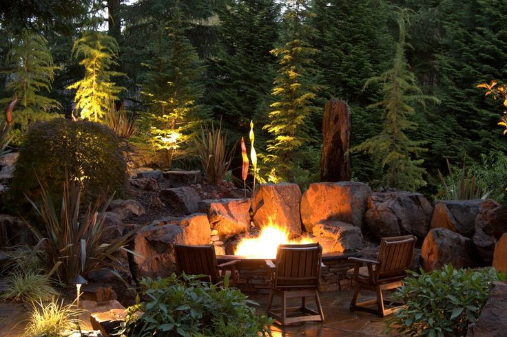 Gorgeous and unique stone fire pit design in the backyard of a Seattle area home. From 1 of 8 projects by Alderwood Landscape, discovered on search.porch.com #outdoorliving #fire #pnw
