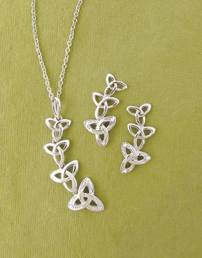 "A series of trinity knots trip the light fantastic in a scintillating dancing pendant that sings and sways with subtle movement. Pave diamonds add a final touch of sparkle. Coordinating earrings arc in a playful curve. Sterling silver and diamonds. Pendant on 18"" chain. Made in Ireland. - Trinity Knot Diamond Jewelry"