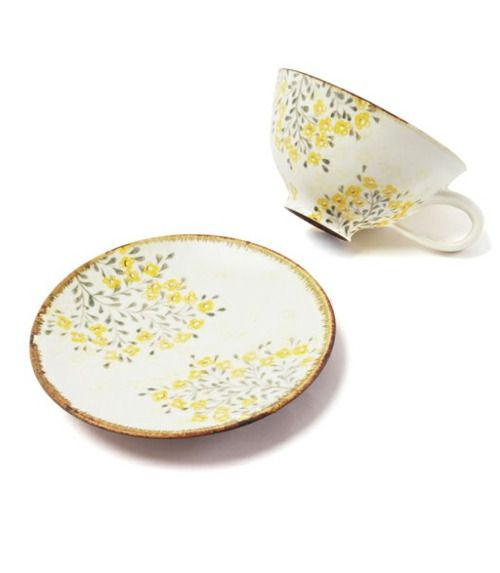 Yellow floral tea cup and saucer.