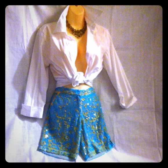 """ADAM LIPPES Sequined Shorts These one of a kind beauties are turquoise and orangey sequins. There is only the slightest show of missing sequins as seen in pics 3 and 4. It is unnoticeable because of where they are and does not detract from the shorts. Fully lined, 2 front pockets and 2 back pockets. Approximate measurements W 30"""" H 34"""" Rise 8"""" Inseam 8"""" Leg Opening 9"""".  Front center zipper and hook and eye closure. Back pockets still closed. Price is firm brim my closet to yours! Adam Lippes…"""