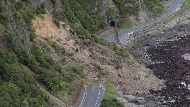 A massive Kaikoura slip not only covered the road, it pushed a stretch of rail line into the sea.