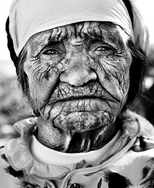 Maroc woman. Old woman, lady, female, map of life, lines of life, wrinckles, pain, hurt, expression, powerful face, beauty, portrait, photo b/w.