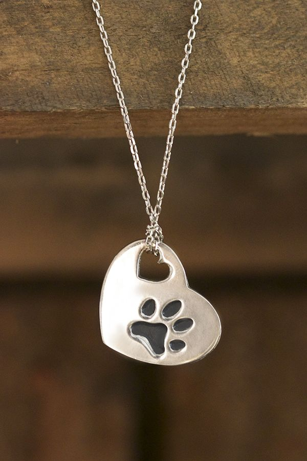 """Your pet came into your life and made an indelible mark on your heart. Share the love with our heartfelt pendant, bearing the message """"You touched my heart"""" and a paw print on the opposite side."""