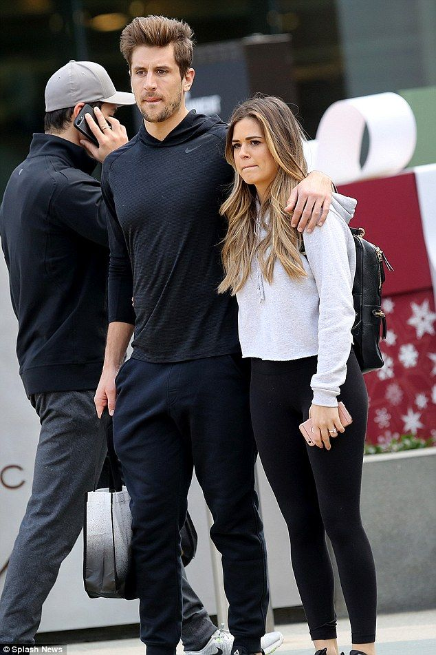 Going strong: JoJo Fletcher, 26, snuggled up to her fiance Jordan Rodgers, 28 on a day out shopping at Santa Monica's 3rd Street Promenade