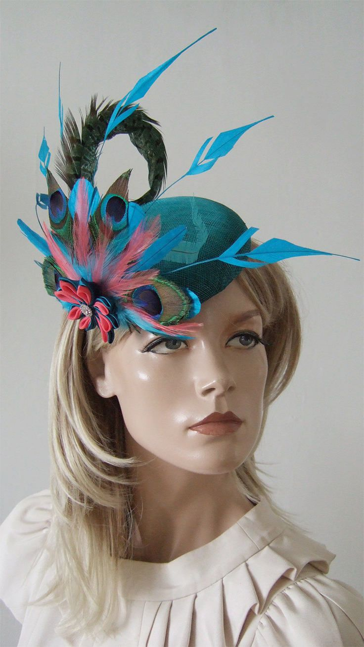 Turquoise Teal Coral Peacock Large Ombre Button Headpiece Fascinator. Perfect colour combination of tranquil lagoon turquoise and coral, handmade in the UK with Peacock feathers, hand dyed ombre sinamay, pheasant feathers and trimmed coque. Great headpiece for friends wedding, or horse races. Racing fashion outfit ideas + inspiration. Available on Etsy, can be customised. Handmade to order. #handmade #shopsmall #peacocks #fascinators #accessories #royalascot #fashion #millinery #hats…