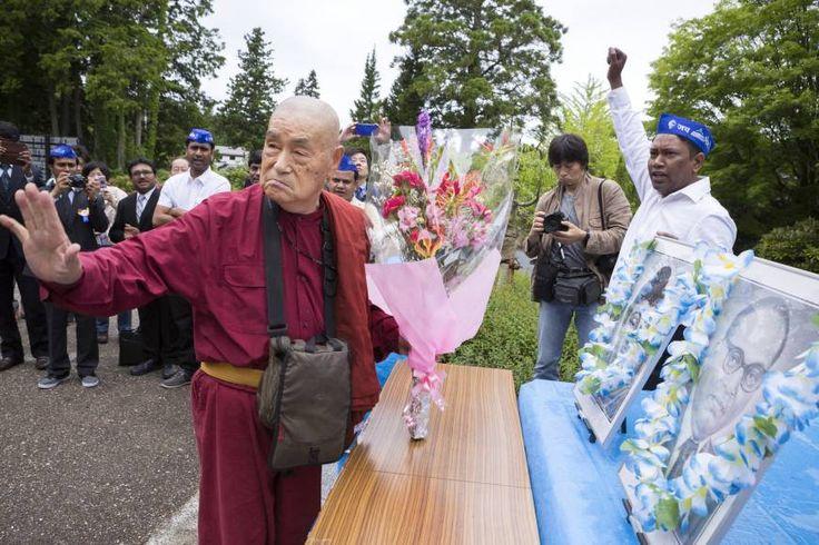 Japan-born monk Surai Sasai leads a prayer ceremony at the headquarters of the Shingon Buddhist sect on Mount Koya, Wakayama Prefecture, on June 14. The portraits depict Buddha and Dalit social reformer Bhimrao Ramji Ambedkar.