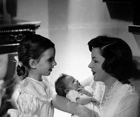 Judy Garland with daughters Liza Minnelli and Lorna Luft (baby), 1953.