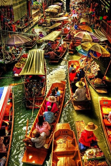 Floating market, Thailand. This has to be a must for people traveling to Asia.