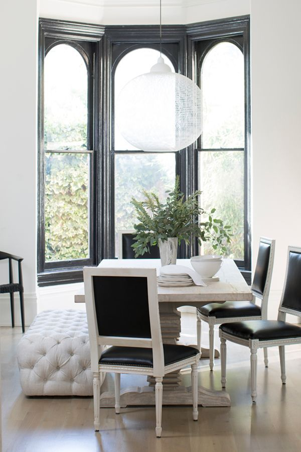 black and white interior design inspiration - formal dining room in a victorian fixer upper
