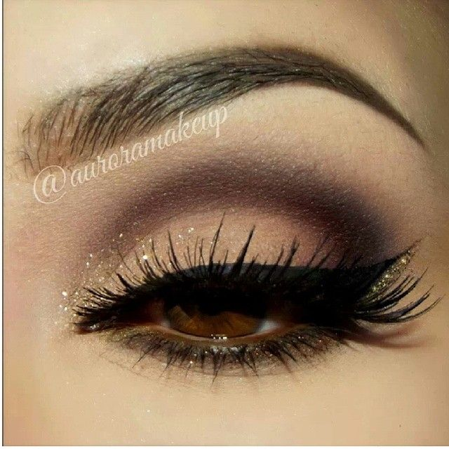 Smokey eye makeup, winged liner - cut crease eyeshadow in shades of brown with gold glitter.