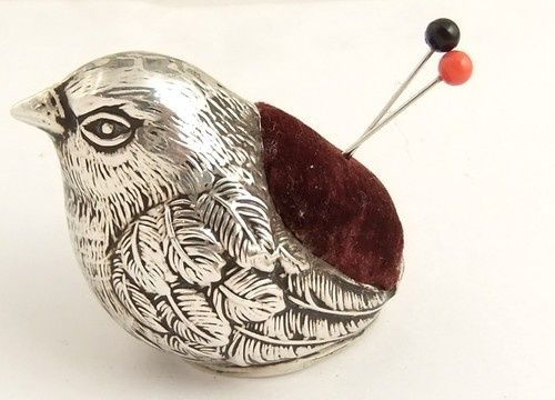 cute antique silver pin cushion.
