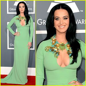Katy Perry went old school, channeling Priscilla Presley for the Grammys 2013. loving her deep, dark solid color hair.