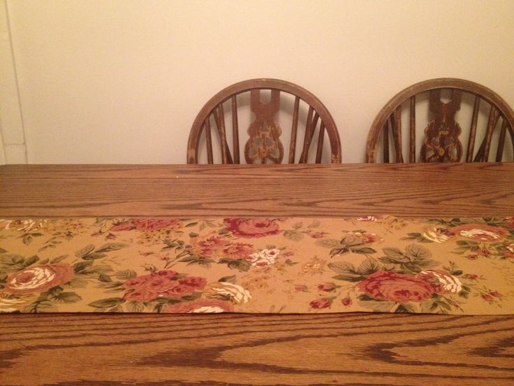 Homemade table runner in a vintage dress floral fabric on my secondhand table complete with £2 chairs
