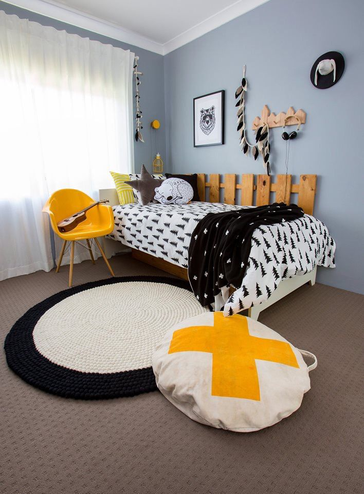 Monochrome room with splash of yellow. Featuring Happy as Larry's new rug range