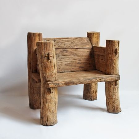 Solid elm wood log chair. Raw finish with beautiful wood grain. Vintage piece with mortise and tenon style pegs holding legs and seat in place. Interesting piece for interior or exterior.
