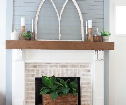 Fireplace Makeover After: painted brick with tones of browns and creamy whites, white surround, stained wood mantle. Would be great for the living room fireplace makeover   The Lettered Cottage
