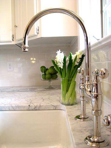 kitchens - glossy subway tiles backsplash white kitchen cabinets marble countertops farmhouse sink polished nickel gooseneck bridge faucet Gorgeous #CambriaQuartz