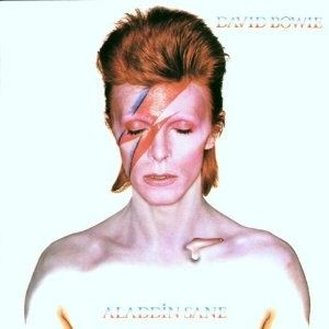 Top 50 Most Iconic Album Covers - IGN  - David Bowie/Aladdin Sane - The sixth album in Bowie's catalog follows his 1972 concept album, The Rise And Fall Of Ziggy Stardust. The cover finds the father of glam rock shirtless, embracing his rock star status, with a red lightning bolt painted across his right eye. It was one of many Bowie covers to focus on his distinctively flamboyant look.