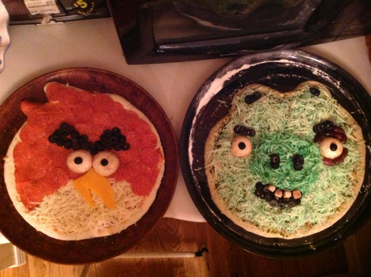 Pepperoni Angrey Bird Pizza & Chicken Pesto with Kalamata Olives Pig. Little bit of green food coloring in the cheese goes a long way when melted.