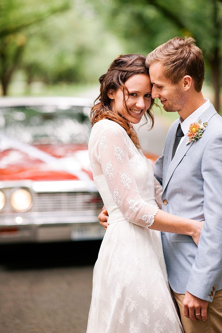 cute couple wedding day red car location photos. light blue suit jacket, chinos, DIY wedding.