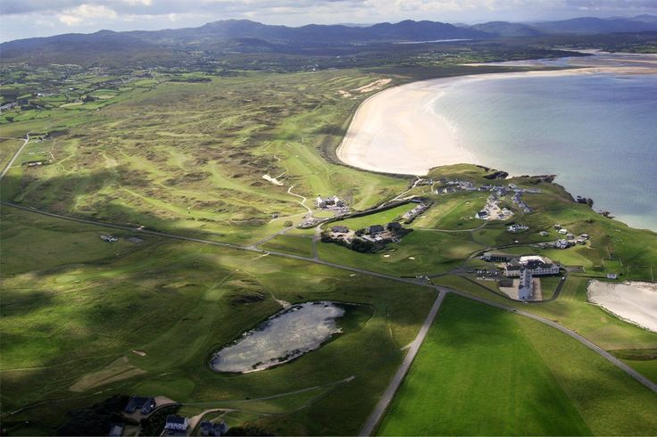 Flyview from north over Coast Quard course and Rosapenna Hotel & Golfclub and behind Old Tom Morris back nine at the beach and Sandy Hills Links on the letf.  Some fairways of the 2 x 18 holes St Patricks Golf course can be seen behind OTM.