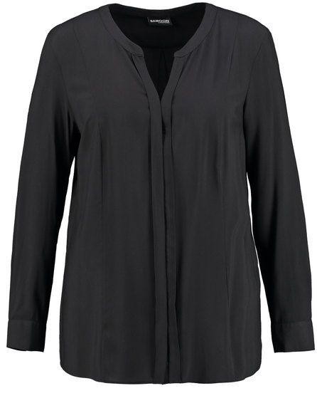 Zeer eenvoudig en daardoor zeer stijlvol! De vloeiende blouse is er in een elegante stijl met vrouwelijkedetails, lange mouwen met manchet en vrouweli...