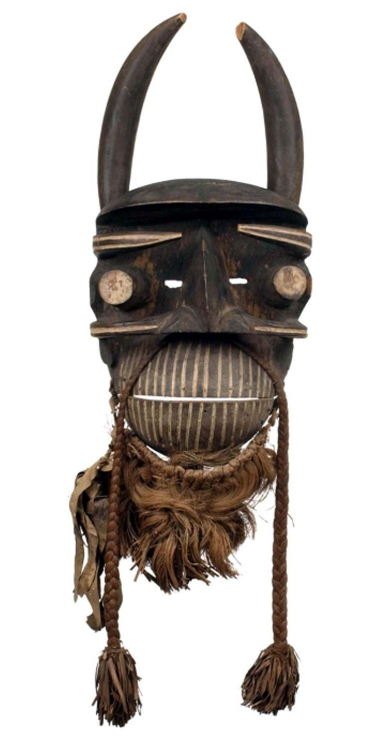 Africa | Mask, with mobile jaw and horns,  from the We people of the Ivory Coast | Wood, pigment and natural fiber | ca. 1955 or earlier