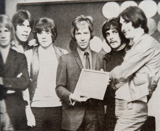 Collect picture of John Schroeder with members of Status Quo