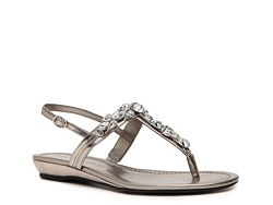 Unisa Lady Wedge Sandal since I get to wear flats else my dress be too short!  :)