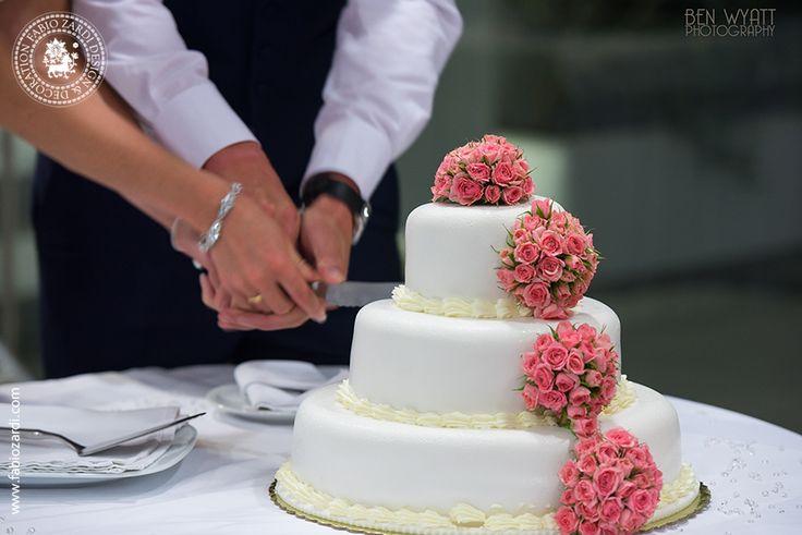 Wedding of Kate Davies & Matthew Reynolds Santorini, July 26th, 2014  Cake decoration with small flower arrangements.  Wedding venue: Santo Wines Reception venue: Pyrgos Restaurant Wedding photographer: Ben Wyatt Photography