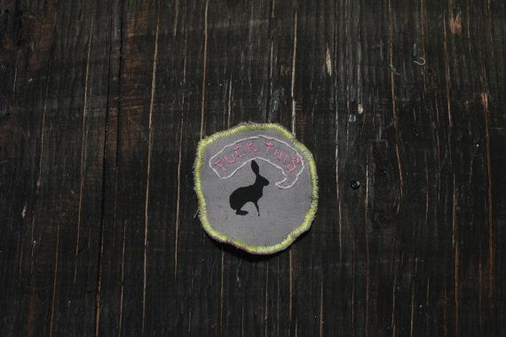 This badge was hand printed with black fabric ink and heat set. Text was hand stitched after backing was sewn on. size: 5 cm    This item was made