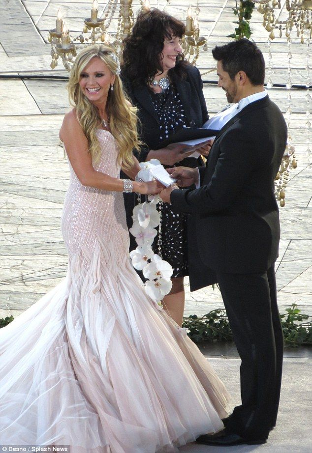 Bride wore white: Tamra Barney was ravishing in white as she wed her beau of three years Eddie Judge in Laguna Beach, California on Saturday.  Gorgeous Wedding Dress
