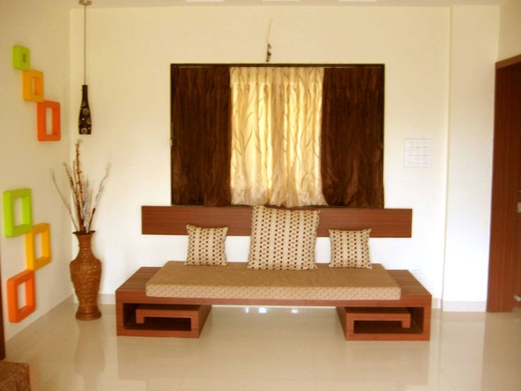 A staple in traditional Indian homes, the diwan is a low-sea…