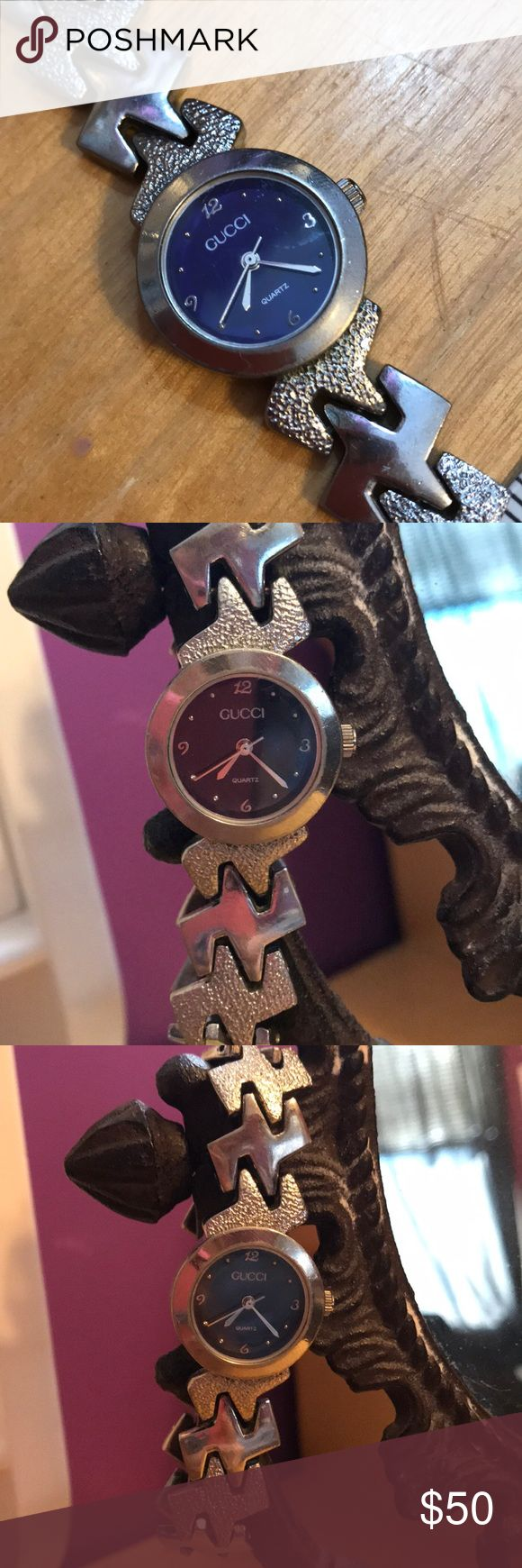 Gucci mood watch Gucci mood watch, silver metal linked wrist band. The center changes color based on mood/temperature. NEEDS NEW BATTERY. I bought this at a second hand shop so I cannot guarantee authenticity. Any questions please comment below. Open to offers. Gucci Accessories Watches