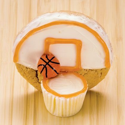 Basketball Cupcakes  Mini white cupcakes (ours is 1 inch tall)  White frosting  Orange decorators' gel  Sugar cookies (3 inches in diameter)  Mini basketball chocolates (or gumball with food coloring lines)