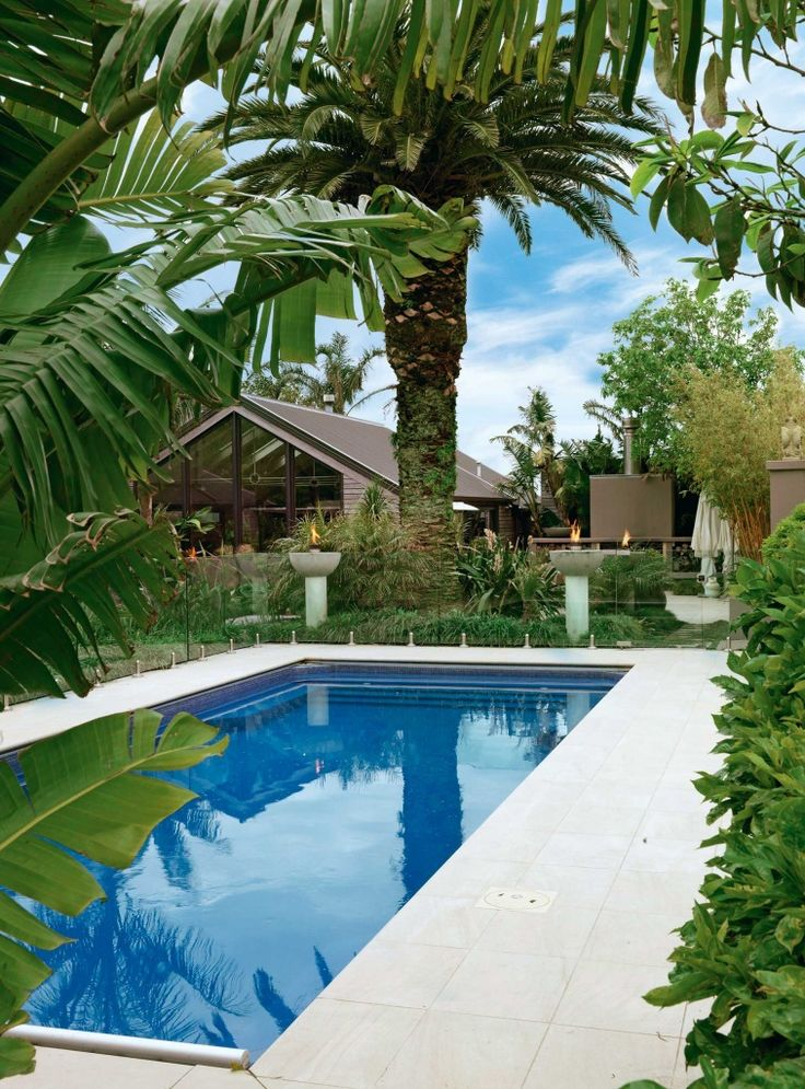 Delwyn and Bryce Barnett asked Taranaki landscape designer Mike Mansvelt for a tropical resort feel when he redesigned this area.