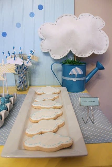April Showers birthday - cloud cookies, watering can centerpieces and check out the clouds on the straws!