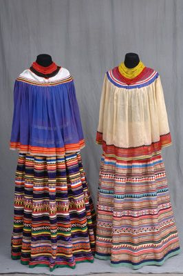 Seminole People of Florida: Survival & Succcess. (Left) Cape and shirt, ca. 1954. (Right) Cape and skirt, ca. 1935-1945.
