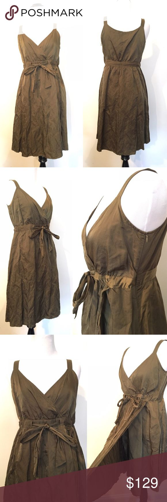 """Eileen Fisher 2P Petite olive Metallic Dress Gorgeous rich color right fabric imported from  Italy . Lined dress  Faux wrap (no unwanted surprises here !)  V neck  Tie around the waist area  Side zip   Pit to pit : 17.5""""  Waist at tie: 15""""  Collar to hem: 31""""  Any questions please ask Eileen Fisher Dresses Midi"""