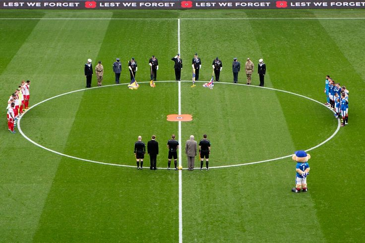 Rangers and Kilmarnock players are joined by members of the forces, Remembrance Day 2016.