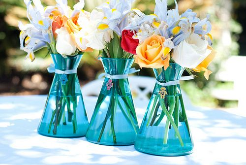 Beakers as vases!!!! Perfect for science lovers! (What an awesome idea.)