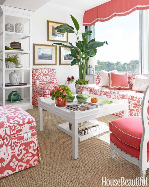 "In a Palm Beach, Florida, living room, Quadrille's Island Ikat on the banquette and chairs creates the atmosphere of ""a tropical cabana,"" says designer T. Keller Donovan. The valance in Brunschwig & Fils' Coral is embellished with Robert Allen's Scroll Braid. Slipper chairs from Duralee are ""big enough for two people to sit and share secrets."""
