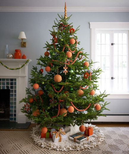 You don't have to decorate with red on your Christmas tree. We love this tangerine and charcoal gray theme, too.