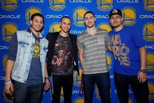 Stephen Curry and Klay Thompson of the Golden State Warriors take a picture with their brothers Seth Curry and Mychal Thompson on March 9, 2014 at Oracle Arena in Oakland, California. (Photo by Rocky Widner/NBAE via Getty Images)