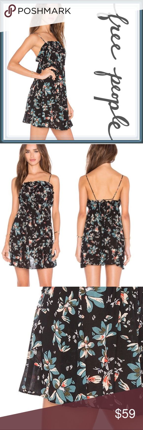 NWT Free People Floral Jolene Mini Slip Dress ➖NWT ➖BRAND: Free People   ➖SIZE: Small ➖STYLE: Jolene Printed Mini Dress in the black combo. The dress has a straight elasticized neck and empire waist, a ruffled hem, scoop back and is pullover style. The straps are adjustable but not in the traditional way. They loop through two holes in the back. The photos show it more clearly.  ➖MATERIAL : 100% Rayon   ❌ NO TRADE   Floral Homecoming prom short tank top Slip dress sexy club blue…